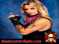 Vince Neil - long cool woman in a black dress - pic 1 small